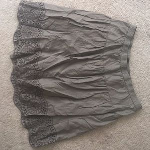 Small, brown skirt with patterned hem